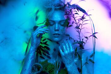 beautiful in a fantasy image Body art model lies in a d cor fog