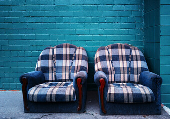 Pair of vintage armchairs on the city street background