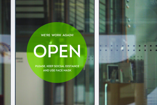 Open store, sign on the front door after quarantine. Welcome back! We are work again. Please, keep social distance and use face mask