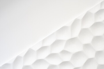 White wall with a wavy texture. Gypsum panels with geometric patterns. Embossed wall in neutral...