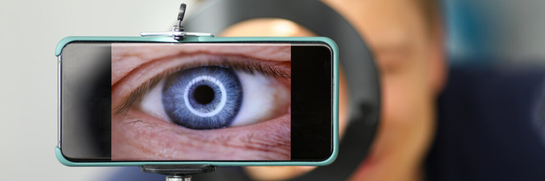 Man making video trying to shoot his own eye using modern smartphone camera