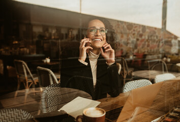 Woman using a mobile phone in a cafe