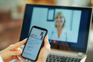 modern woman with electronic rx and doctor on video call