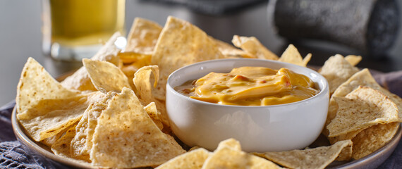 mexican hot queso cheese dip with corn tortilla chips on plate