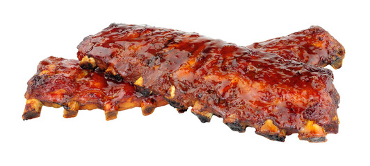 Slow cooked Peking style racks of pork ribs with a sticky plum sauce covering isolated on a white background