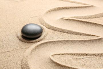Photo sur Toile Zen pierres a sable Stone on sand with lines. Zen concept