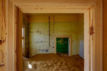 Sand has invaded and taken over these rooms in Kolmanskoppe, Namibia