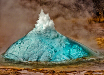 Geyser in Iceland begins eruption by first forming a bubble of hot water, before bursting into the air