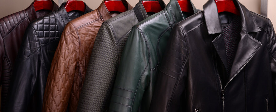New collection of different color spring leather jackets for men. Colorful background of modern outerwear.