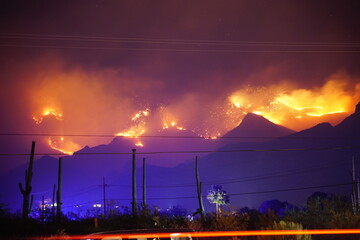 Lightning caused wildfire burning through a mountain range in the southwestern United States of America's Sonoran Desert