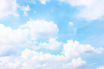 Pastel blue sky with white haep clouds