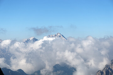 Peak of Antelao mountain looking out of clouds, Alps, Italy