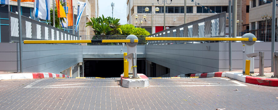 yellow automatic barrier at the entrance to the parking lot