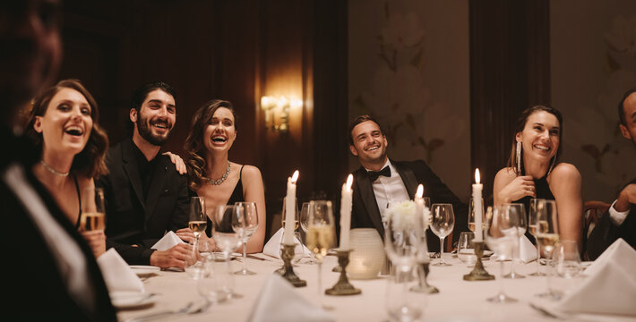 High society people having gala dinner party