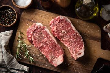 Wall Murals Steakhouse seasoned raw sirloin beef steak on cutting board