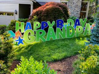 Fototapeta A huge yard sign wishing Grandpa a happy birthday. obraz