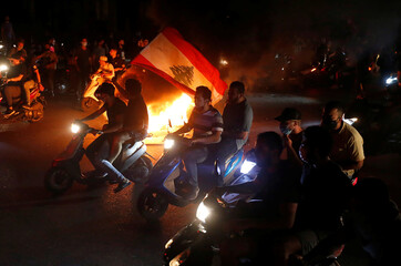 Demonstrators ride on motorbikes during a protest against fall in Lebanese pound currency and mounting economic hardship in Beirut