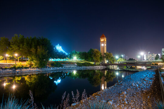 The Great Northern Clocktower and Pavilion along the Spokane River illuminated at night in downtown Riverfront Park in Spokane, Washington, USA