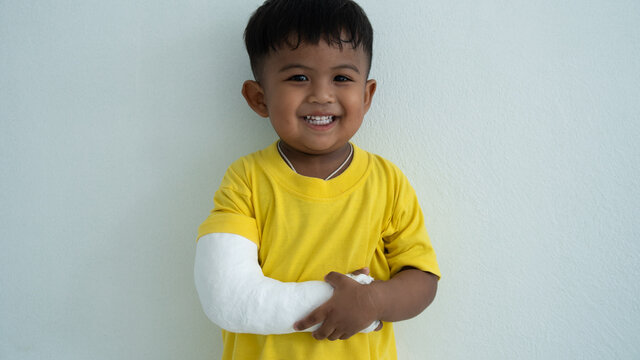 Cute boy hand bone broken from accident with arm splint