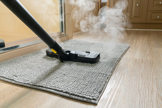 Cleaning bathroom mat using steam cleaner