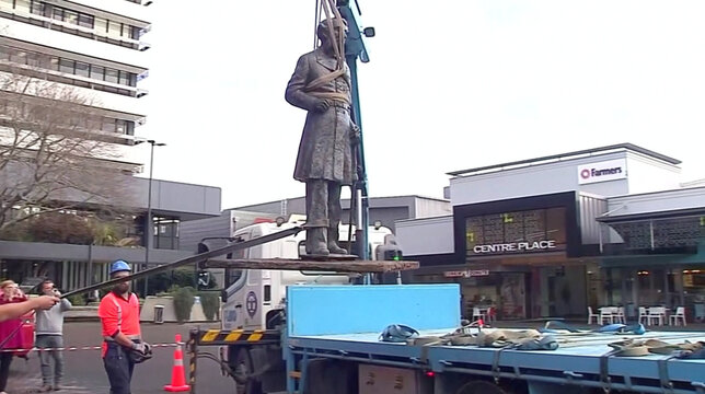 Statue of British Naval Captain John Fane Charles Hamilton is lifted out of the ground and onto a truck in Hamilton