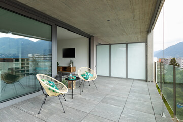 Photo Blinds Equestrian Large terrace of a luxury apartment. Two poltropne for relaxation and a small table are in the center.