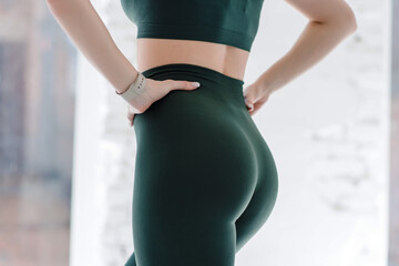 Fotobehang Ezel Cropped close up view photo of sexual sporty sportive tempting beautiful attractive nice round ass wearing green tight pants leggings