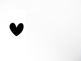 Black heart against white background