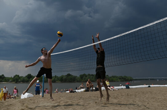 People play volleyball at the beach on the bank of the Irtysh River in Omsk