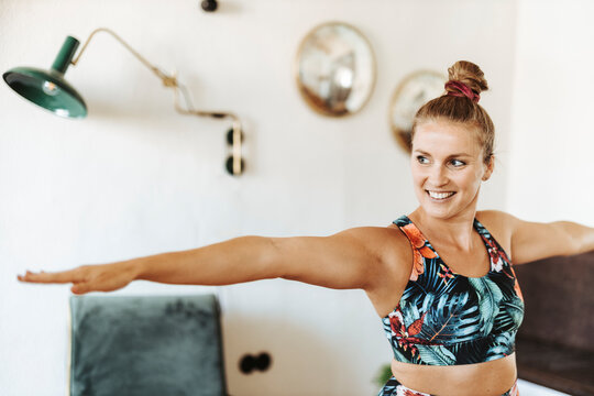 Portrait of woman practicing yoga at home