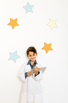 Boy with clipboard playing researcher
