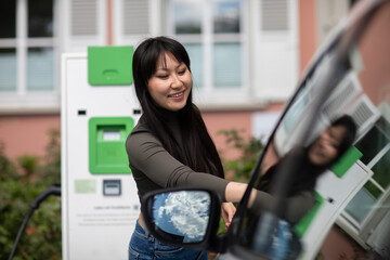 Carsharing, woman renting an electric car