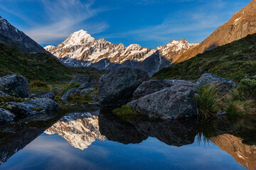 New Zealand, Canterbury, Mount Cook reflecting in small pond at dusk