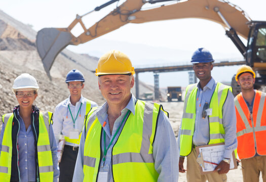 Business people standing in quarry