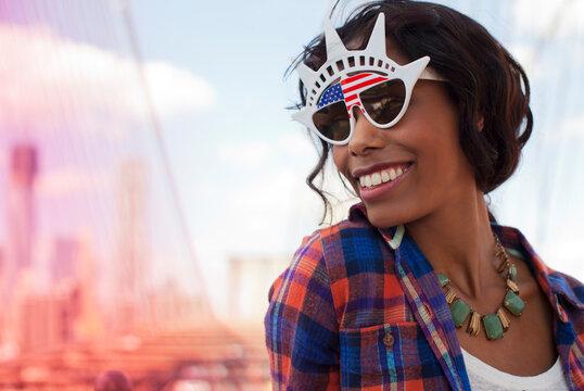 Woman wearing novelty sunglasses on city street