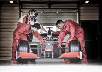 Acrylic Prints F1 Racing team working in garage