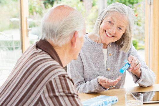 Couple organizing pills