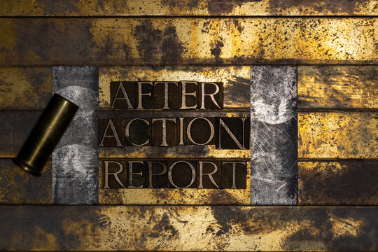 Photo of real authentic typeset letters forming text After Action Report with bullet casing on vintage textured silver grunge copper and gold background