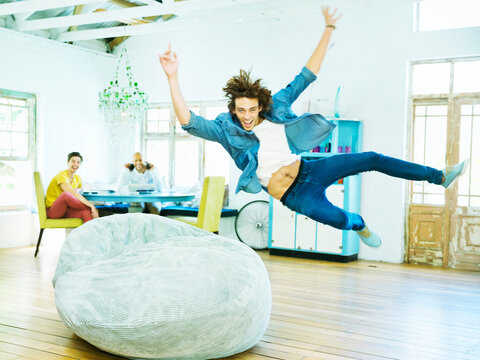 Man jumping into beanbag chair