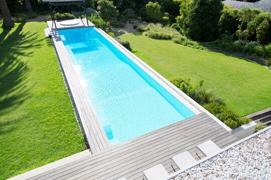 Sun shining on luxury lap pool