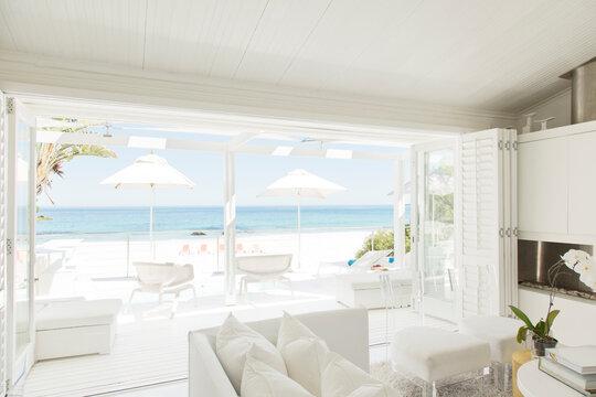 Modern living room overlooking beach and ocean