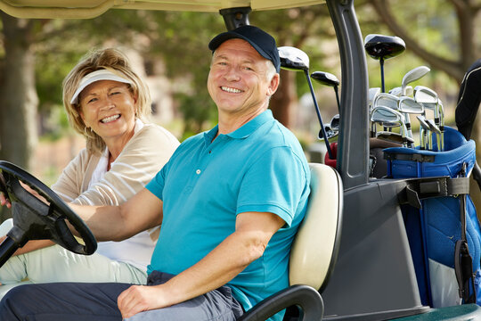 Senior couple smiling in golf cart