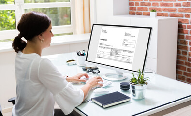 Young Woman Doing Online Invoice Management