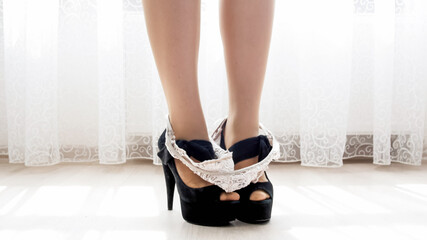 Autocollant pour porte Ane Lace panties on sexy female feet wearing black high heel shoes