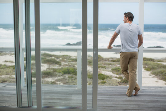 Man looking at ocean view from deck