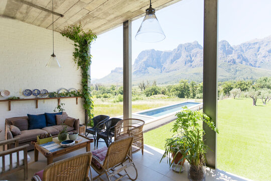 Living room overlooking backyard and landscape