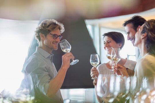 Friends wine tasting in winery tasting room
