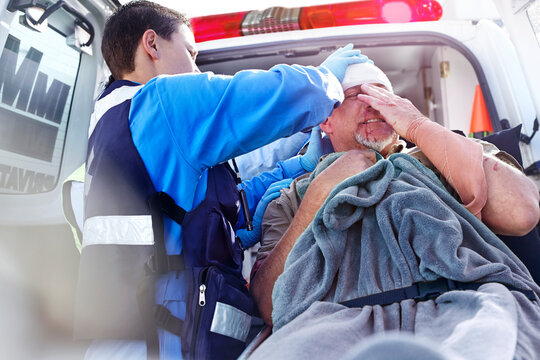 Rescue worker tending to patient at back of ambulance