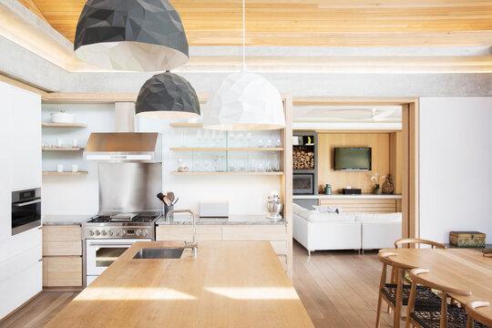 Modern pendant lights over wood kitchen island