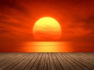 Fototapeten Rot light sunset orange sun calm orange sea with sun through nature horizon over the water with a cloudy sky.